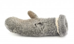 Old gray frayed mitten isolated over the white background